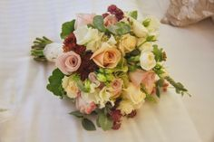 The Bride had a beautifully hand gathered Bridal Bouquet, I'd included a collection of nude toned Roses, Poppy Seed Heads, Lissianthus, Veronica, Sedum, Astrantia, Wax Flower Blossom, Snowberries, Classic Hydrangeas and surprisingly for October some delicately fragranced Sweet Peas