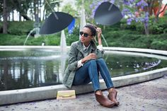 unofficial uniform | button down top, military jacket, skinny jeans, brown bootie boots, neon clutch #ootd #stylemegrasie