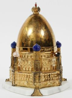 """THEO FABERGE STERLING & 22KT GOLD 'THE KIEV EGG' H 6 1/2"""", ENCASED:In original box. Hallmarks: rampant lion, leopard head, date letter """"U"""" for 1994. . Limited edition #19/750. inspired by the elegance and architectural beauty of the cathedrals and churches in the city of Kiev. A sterling silver Egg surmounted by the Imperial Crown, enriched with 24 carat gold and cobalt blue enamel, rests on a white marble base."""
