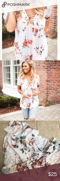 FLORAL LACE UP TOP Floral top accented with a sassy lace up detail in the front!          Small 0/4 Medium 6/8 Large 10/12 Tops Blouses