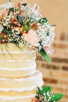 Naked, floral topped cake captured by Kayla Coleman Photography. #wchappyhour #weddingchicks http://www.weddingchicks.com/2014/07/25/wedding-chicks-happy-hour-31/