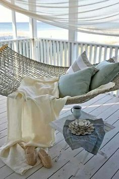 Relax. Gorgeous hammock, fluffy blue pillows, and I'm pretty sure that's a beach in the back. :)