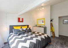Tracy revives a kiwi icon | Habitat by Resene Best White Paint, White Paints, Neutral Color Scheme, Colour Schemes, Aluminium Joinery, Timber Walls, Living Area, Living Room, Black Kitchens