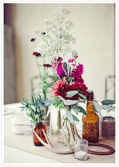 rustic bottle vases and vibrant pink and fuchsia flowers plus horns and horseshoes!  Sure way to add that country twist