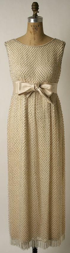 Dress, Evening  Norman Norell  (American, Noblesville, Indiana 1900–1972 New York City)  Retailer: Evelyn Byrnes Date: 1963 Culture: American Medium: silk, glass, plastic