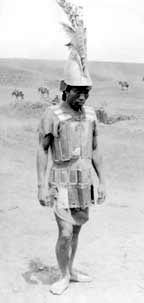 A Moro (Philippine) warrior wearing mail and plate armor and helmet, captured by U.S. soldiers after the 4-day Battle of Bagsak Mountain (1913).