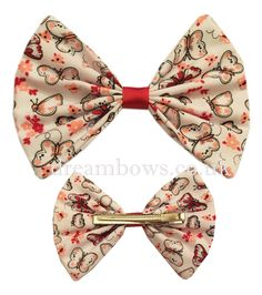 White and red butterfly fabric hair bow on alligator clip - www.dreambows.co.uk #bows #hairbows #largebows #fashion #girls