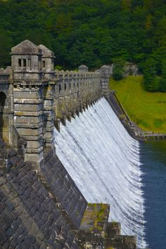 Lake Vyrnwy Dam, Wales built in the 1880s to supply water to Liverpool and Mersyside. The first dame to carry water over the top instead of the side. Wikipedia.