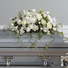 Send Loving Memories Casket Spray in Goodyear, AZ from Thompson's Flower Shop, the best florist in Goodyear. All flowers are hand delivered and same day delivery may be available.