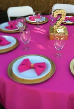Fushia and gold birthday party table!  See more party planning ideas at CatchMyParty.com!