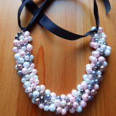 Learn how create beautiful pearls necklace with black ribbon. (in Polish)