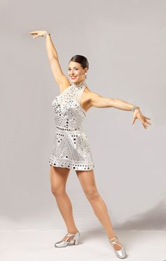 "The ""Mirror"" costume was designed by Gregg Barnes and was introduced by the Rockettes in 2003. #rockettes #NYC #costumes #dancers #glamorous #white  #silver #sparkle #mirror"