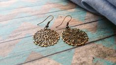 Oxidized Brass Filigree Earrings by Hannah Ballenger at The Artisan Studios. Check out our Etsy shop to see these amazing boho/chic filigree earrings that won't leave a dent in your budget.