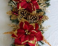 Snowman Swag, Christmas Swag, Christmas Wreath, Snowman Wreath  This is a Snowman Swag made with red, green, and white deco mesh. Mesh ruffles in White snowball and red and white. Lots of wired ribbon bows placed throughout. There is a metal snowman with lighted eyes in the center, 6 snowflake snowmen with 4 red/green/white christmas balls.   Measures 18 wide x 32 long Ready to Ship  Only 1 available