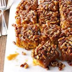 Caramel-Pecan Pumpkin Pull-Aparts Recipe -We love sticky buns made with my husband's angel biscuit dough, caramel and pecans. For a twist, try apple butter or applesauce instead of the pumpkin. —Carolyn Kumpe, El Dorado, California