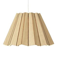 Dress up your space with this modern Cardboard Pendant Light. Made of laser cut ecological corrugated cardboard, the pendant light is lightweight, easy to use and versatile. Hang it over your dining table, or cluster a few together to liven up any home or space.