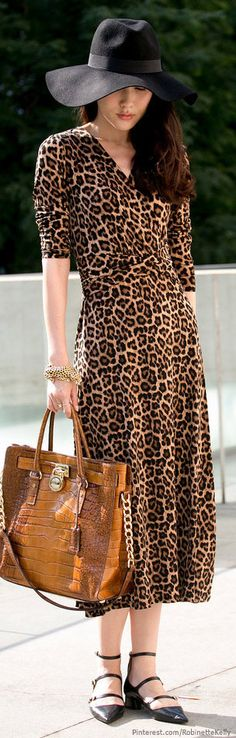 leopard print easy wrap dress and strappy low heels in black leather.  Kors bag.  perfect