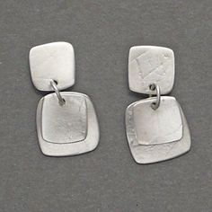 "Kathleen Faulkner: Rice Paper, Earrings in sterling silver. 1"" in length."