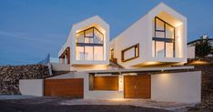 Reload Épitészstudio have designed this modern house that sits a top a hill in an area north-east of Budapest, Hungary.