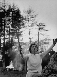 """1964 Terence Spencer—The LIFE Images Collection/Getty Images Caption from LIFE. """"Ray Bone, high priestess of the London witch coven, raises sword and asks 'Mighty Ones of the East' to protect the ritual circle in which they gather near Chipping Norton. Witches behind her hold up knives."""""""