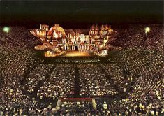 Inside the 2000 year old Verona arena see an opera under the moonlight