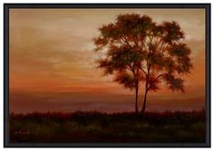 At sunset, a single tree is illuminated by the fading light. This stunning wall art is complemented by a simple black frame and will add a note of grace and beauty to your room.
