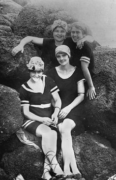 27c4ed0fb0c4b Four women in woollen swimsuits pose on rocks on the beach at Tweed Heads