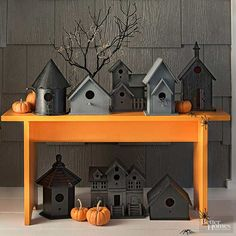 Welcome guests to your home with a haunted birdhouse town that is full of Halloween charm (and a few plastic spiders). Make the Halloween craft: Round up an array of wooden birdhouses and coat them with glossy black and matte gray spray paint. Position your tiny town on a vibrant orange bench, and garnish the display with an eerie branch and mini pumpkins. Use adhesive to secure the spiders in place.