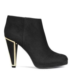 Dressy ankle boots in black imitation suede with gold-tone, metal-edged heels and pointed toes. Side zip, fabric lining, and rubber soles. | H&M Shoes