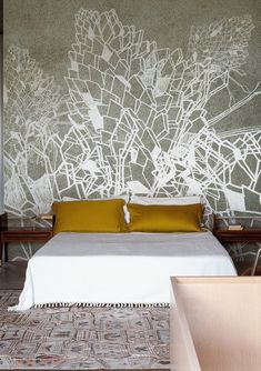 Wallpaper/mural--white geometric on grey, white quilted-bed w mustard shams