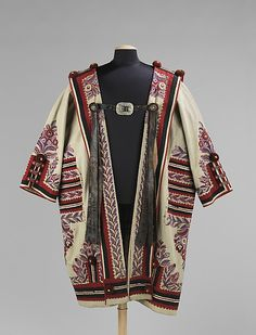 The Hungarian szür is derived from mantles over 2500 years old, and continued to be worn into the early 20th century. The garment was worn by shepherds mostly, providing protection from the harsh elements. Their thick wool felt was protective against cold and wet, and the long collars were adorned with roundels at the lower corners that could be connected to form a hood. Generally knee to mid-calf length, they were heavily adorned with embroidery and appliqués specific to their locality.