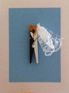 peg art / my homemade wedding card. Open and close the peg so that you may kiss the bride ;)