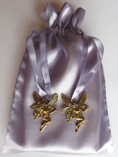 http://www.ebay.com.au/itm/Gold-Goddess-Charm-Lavender-Satin-Tarot-Bag-/331596305707?pt=LH_DefaultDomain_15