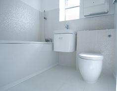 Stunning white tiled family bathroom