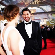 Pin for Later: Stars Give an Inside Look at the 2015 Golden Globes  John Krasinski had nothing but loving looks for Emily Blunt.