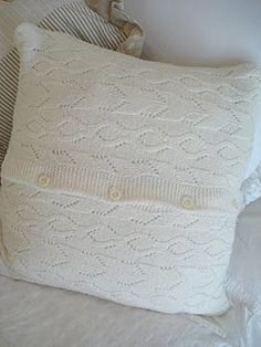 1 old or thrifted button-front sweater + scissors & thread + 15 minutes + a sewing machine = awesome knit pillow with a built-in closure