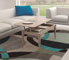 Cool multi-tiered coffee table in front of a white sofa. Mesa centro elevable MC2 Tables by MUEBLES EGELASTA S.L.