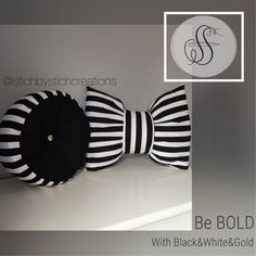 A personal favorite from my Etsy shop https://www.etsy.com/listing/226069287/black-white-stripe-bow-round-pillow-set