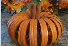 Spray canning lids orange, tie together, insert some cinnamon sticks and instant pumpkin decoration that smells good too! Spray canning lids orange, tie together, insert some cinnamon sticks and instant… Pumpkin Crafts, Fall Crafts, Holiday Crafts, Holiday Fun, Diy Pumpkin, Holiday Ideas, Pumpkin Stem, Holiday Decor, Thanksgiving Ideas