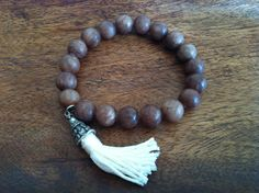 A personal favorite from my Etsy shop https://www.etsy.com/listing/116976341/brown-tassel-bracelet-with-oxidized-cap