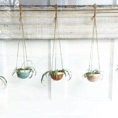 New shipment of handmade stoneware hanging planters. Available in-store & online! #ceramics #stoneware #spring @jennifercreighton