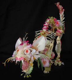 Cat Skeleton decorated with fake flowers by Cedric Laquieze
