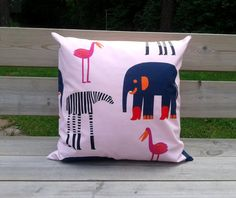 Fun pillow cover made from Marimekko animal print Karkumatka (On the run) in pink. Modern Scandinavian design. This throw pillow cover is perfect as an accent pillow for a baby or a girl room! The fabric is 100% cotton purchased in Marimekko store in Helsinki, Finland.  This listing is for 1 pillow cover only. The back is envelope style. The pillow cover can be machine washed warm. DISCLAIMER: This is not a licensed Marimekko product. It is however, hand-crafted from licensed Marimekko…