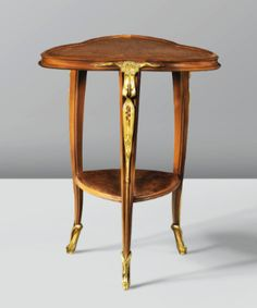 51 LOUIS MAJORELLE 1859 - 1926 GUÉRIDON, VERS 1903 A MAHOGANY, THUYAWOOD AND GILT BRONZE OCCASIONAL TABLE BY LOUIS MAJORELLE, CIRCA 1903 Estimate: 7,000 - 10,000 EUR LOT SOLD. 35,550 EUR (Hammer Price with Buyer's Premium) French Furniture, Classic Furniture, Antique Furniture, Furniture Making, Cool Furniture, Furniture Design, Art Nouveau Furniture, Coffe Table, Interior Decorating