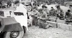 Chaplain Gerald F. Clune conducts Catholic Mass for men of Heavy Mortar Co., 23rd Infantry Regiment,  2nd Infantry Division, at Headquarters, 14 October 1951