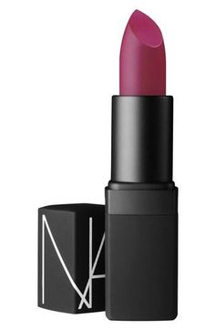 Berry lips by NARS. I personally always like a nude lip but if you do like a bold lip color, I would recommend a berry rather than a red-Souhaila