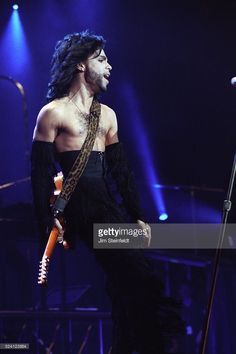 Prince performs during the Nude Tour at the St. Paul Civic Center Arena in St…