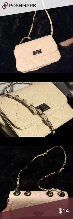 """Beige Faux Leather chained crossbody NWOT, cream or beige colored faux leather quilted crossbody, with silver metal chained embellishments. Aldo look alike. Dimensions are approx: 6""""x8"""" **Not Aldo brand just used it for views, but it looks a lot like Aldo.*Trade value $20* Aldo Bags Crossbody Bags"""