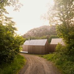 in norway, oslo-based practice reiulf ramstad architects has designed a cluster of three integrated cabins, which are also able to operate individually.