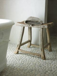 the pebbled floor, rustic stool, vintage tub
